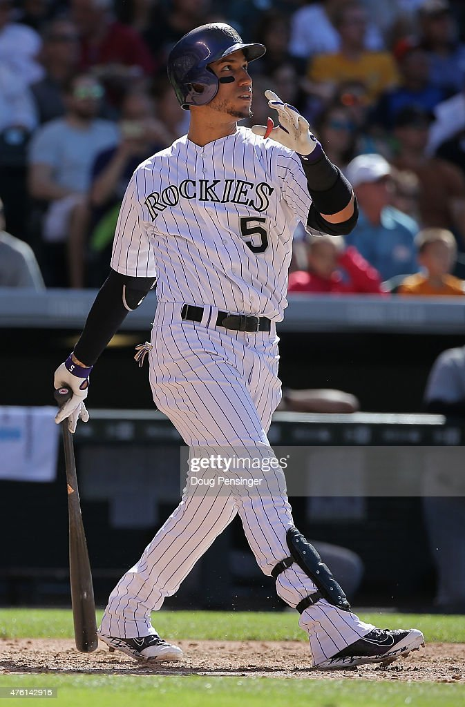 Carlos Gonzalez #5 of the Colorado Rockies hits a three run home run off of starting pitcher David Phelps #41 of the Miami Marlins as the Rockies take a 9-2 lead in the fourth inning at Coors Field on June 6, 2015 in Denver, Colorado.