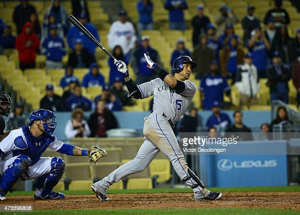 Carlos Gonzalez of the Colorado Rockies hits a threerun homerun for a 54 lead in the ninth inning against the Los Angeles Dodgers during the MLB game...