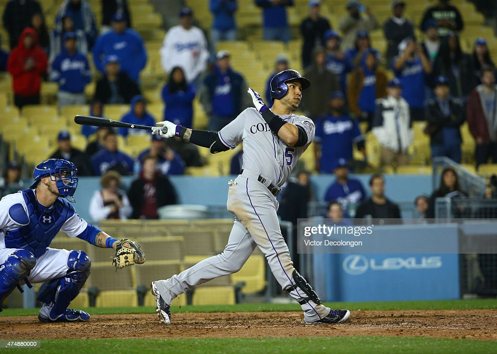 Carlos Gonzalez #5 of the Colorado Rockies hits a three-run homerun for a 5-4 lead in the ninth inning against the Los Angeles Dodgers during the MLB game at Dodger Stadium on May 14, 2015 in Los Angeles, California. The Rockies defeated the Dodgers 5-4.