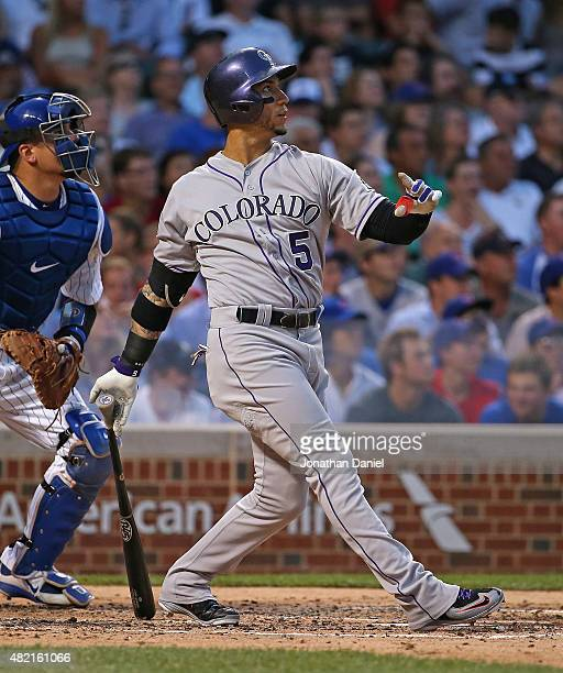 Carlos Gonzalez of the Colorado Rockies hits a tworun home run in the 3rd inning against the Chicago Cubs at Wrigley Field on July 27 2015 in Chicago...