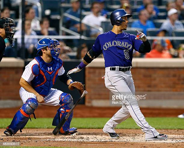 Carlos Gonzalez of the Colorado Rockies hits a tworun home run against the New York Mets during the fourth inning on August 10 2015 at Citi Field in...