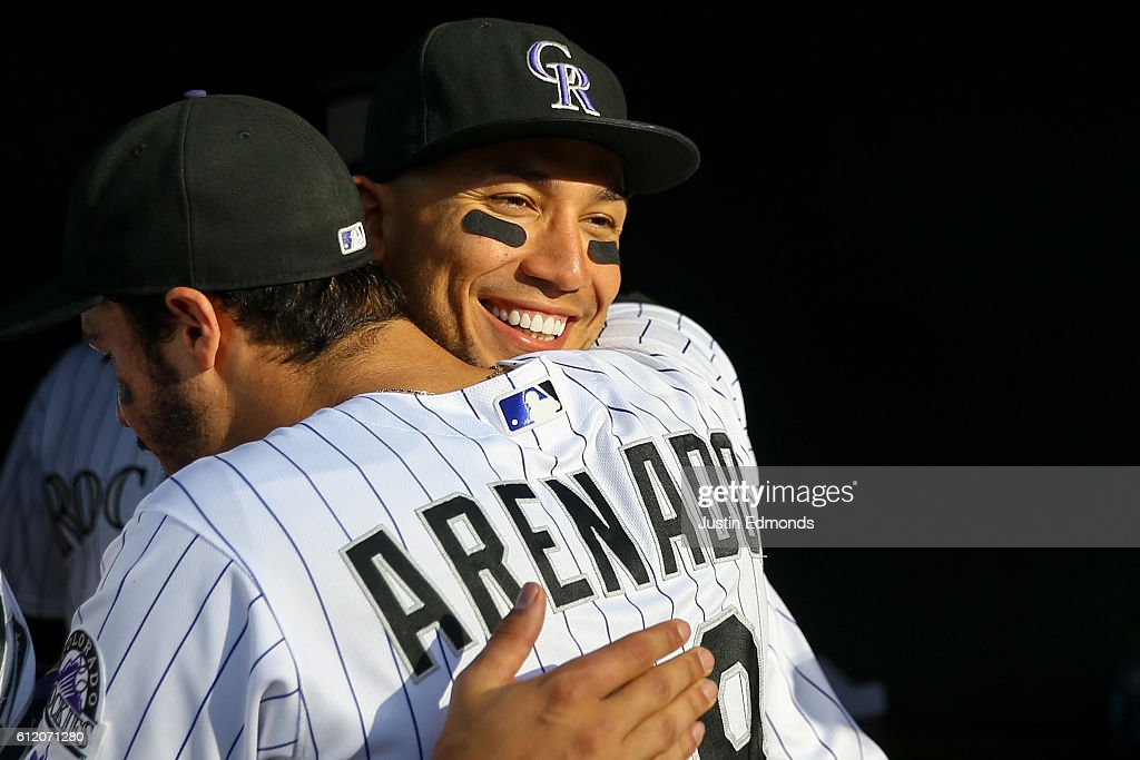Carlos Gonzalez #5 of the Colorado Rockies hugs Nolan Arenado #28 after the final game of the season at Coors Field on October 2, 2016 in Denver, Colorado. The Milwaukee Brewers defeated the Rockies 6-4. The Rockies finished their season 75-87.