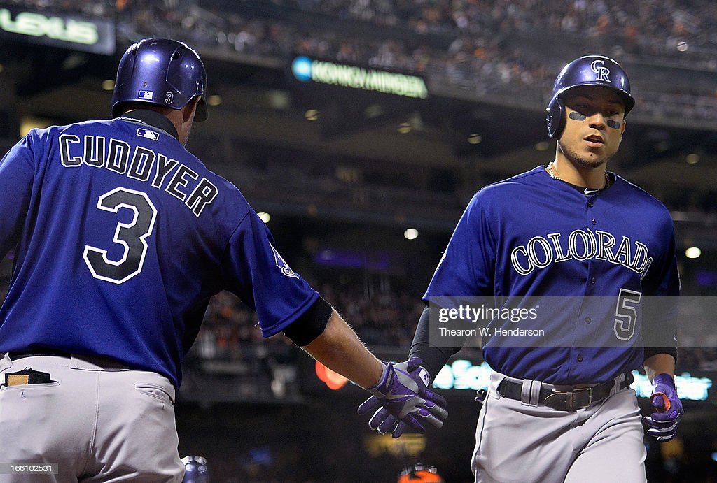 Carlos Gonzalez #5 of the Colorado Rockies is congratulated by <a gi-track='captionPersonalityLinkClicked' href=/galleries/search?phrase=Michael+Cuddyer&family=editorial&specificpeople=208127 ng-click='$event.stopPropagation()'>Michael Cuddyer</a> #3 after Gonzalez hit a solo home run in the third inning against the San Francisco Giants at AT&T Park on April 8, 2013 in San Francisco, California.