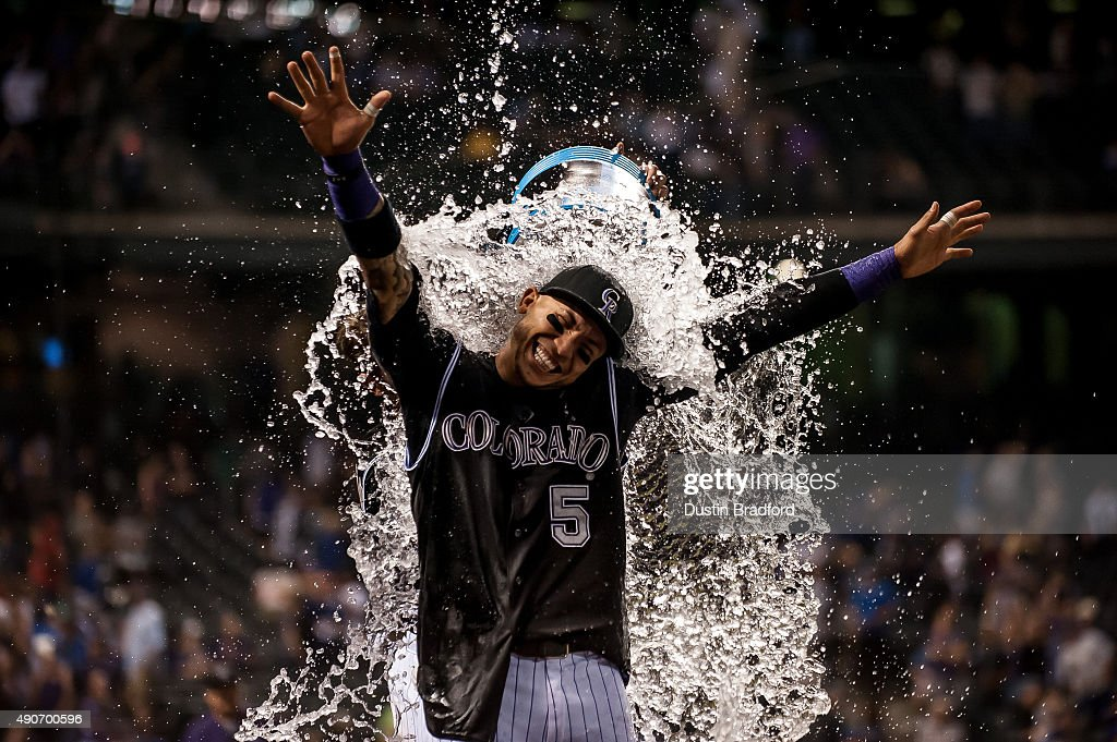 <a gi-track='captionPersonalityLinkClicked' href=/galleries/search?phrase=Carlos+Gonzalez+-+US+Baseball+Player&family=editorial&specificpeople=7204259 ng-click='$event.stopPropagation()'>Carlos Gonzalez</a> #5 of the Colorado Rockies is drenched by a teammate after hitting a walk-off 2-run home run to put the Rockies ahead of the Dodgers 8-6 at Coors Field on September 26, 2015 in Denver, Colorado.