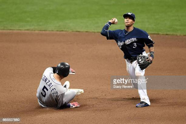 Carlos Gonzalez of the Colorado Rockies is forced out at second base as Orlando Arcia of the Milwaukee Brewers makes a throw to first base during the...