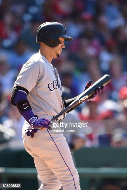 Carlos Gonzalez of the Colorado Rockies looks on during game one of a doubleheader baseball game against the Washington Nationals at Nationals Park...