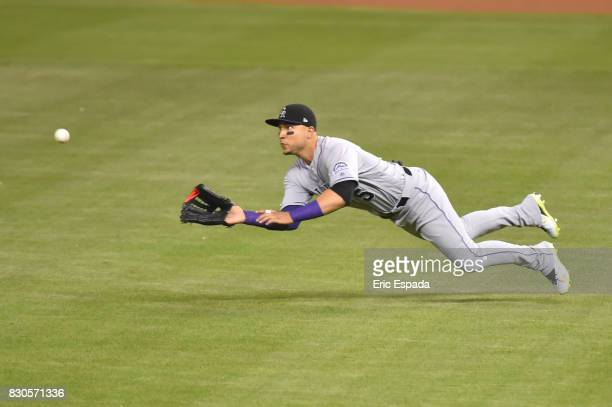 Carlos Gonzalez of the Colorado Rockies makes a diving catch in the third inning against the Miami Marlins at Marlins Park on August 11 2017 in Miami...