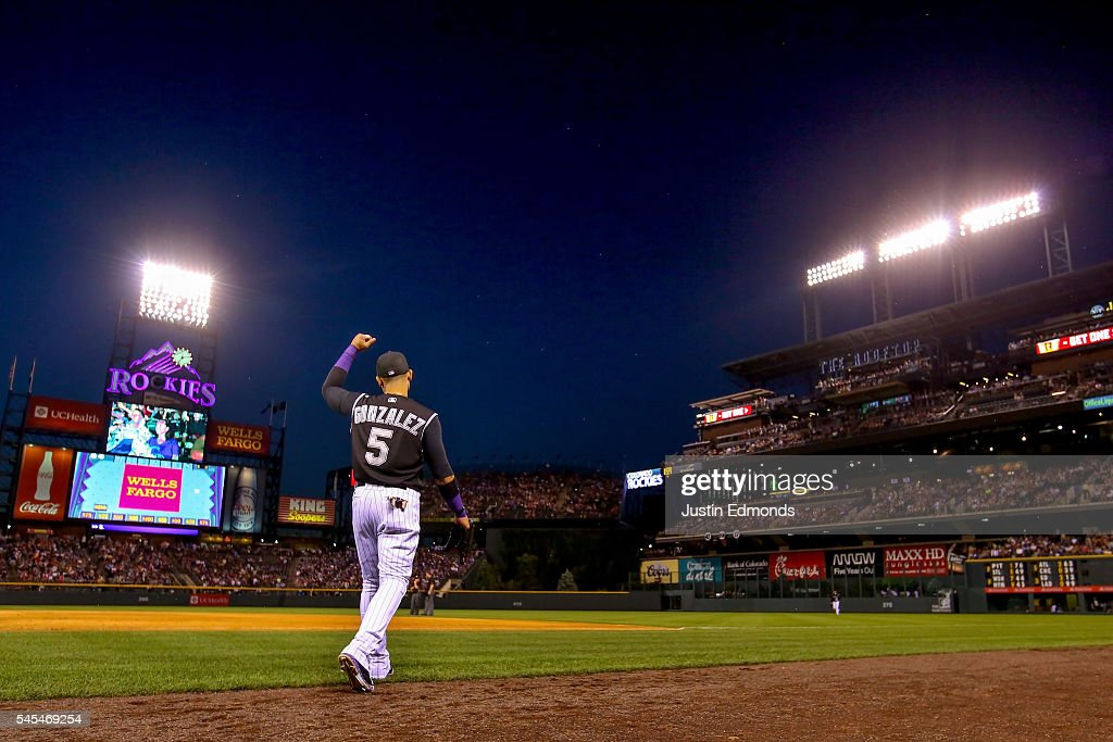 Carlos Gonzalez #5 of the Colorado Rockies pumps his fist while taking the field after the Rockies scored five runs in the seventh inning against the Philadelphia Phillies at Coors Field on July 7, 2016 in Denver, Colorado.
