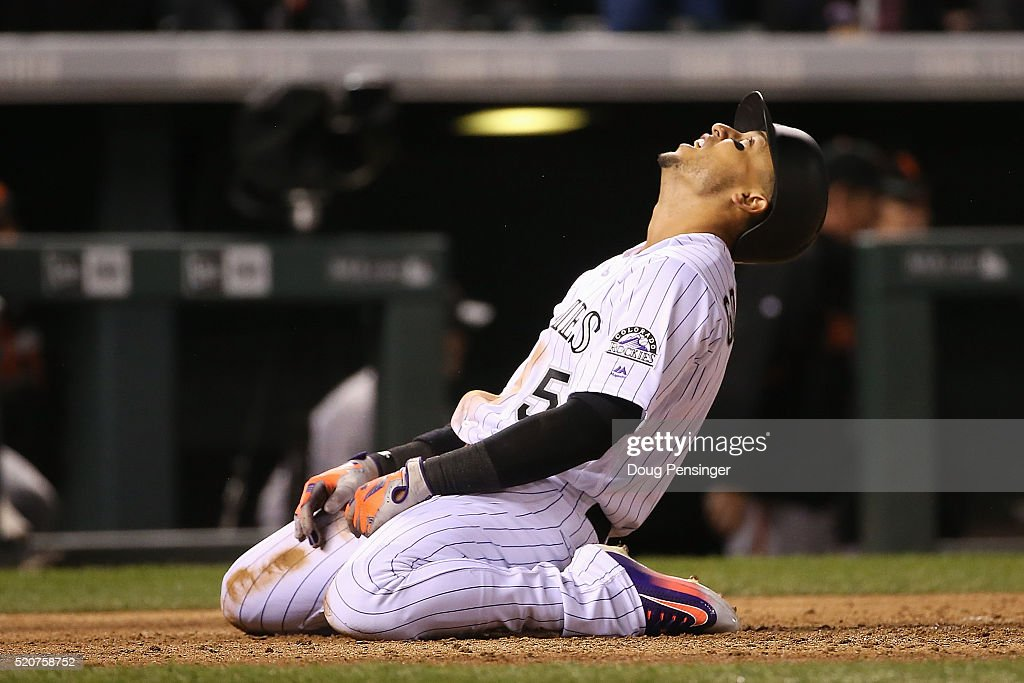 Carlos Gonzalez #5 of the Colorado Rockies reacts after being tagged out at home plate by catcher Trevor Brown #14 of the San Francisco Giants while tying to score on a single by Nolan Arenado #28 of the Colorado Rockies to end the fifth inning at Coors Field on April 12, 2016 in Denver, Colorado.