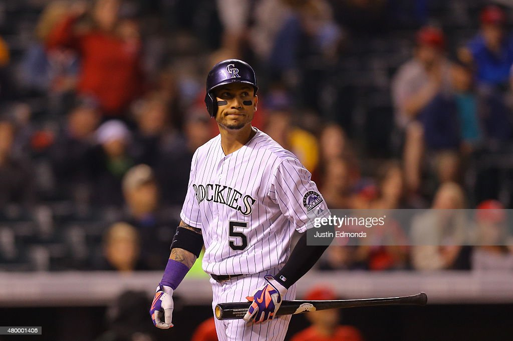 <a gi-track='captionPersonalityLinkClicked' href=/galleries/search?phrase=Carlos+Gonzalez+-+US+Baseball+Player&family=editorial&specificpeople=7204259 ng-click='$event.stopPropagation()'>Carlos Gonzalez</a> #5 of the Colorado Rockies reacts after striking out with a runner in scoring position in the ninth inning against the Los Angeles Angels of Anaheim during Interleague play at Coors Field on July 8, 2015 in Denver, Colorado. The Angels defeated the Rockies 3-2 to sweep the two game series.