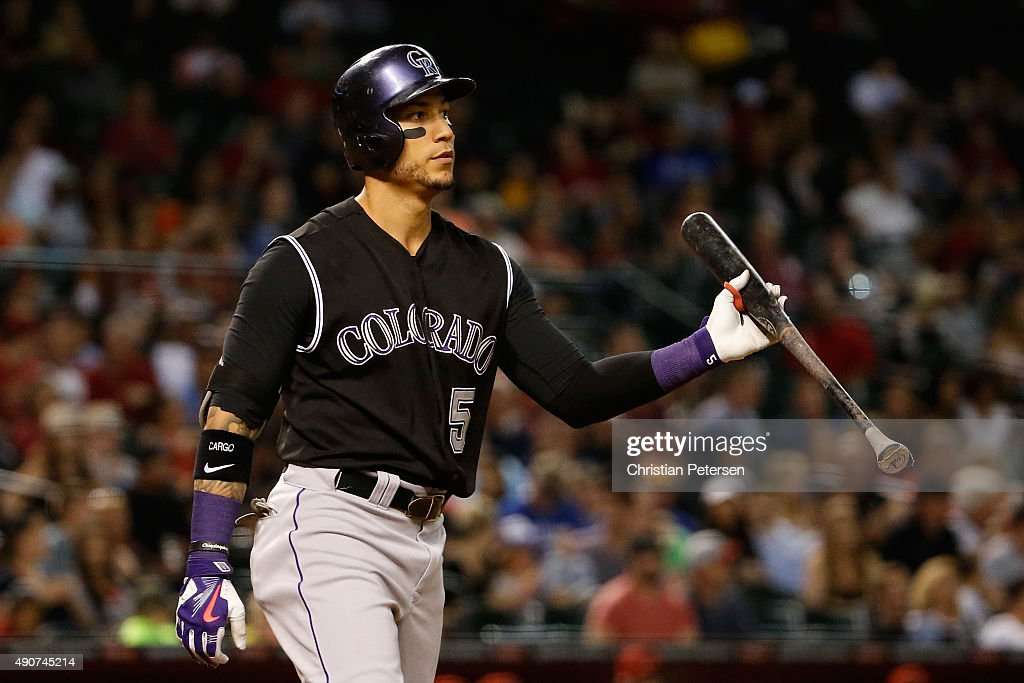 Carlos Gonzalez #5 of the Colorado Rockies reacts after striking out against the Arizona Diamondbacks during the fifth inning of the MLB game at Chase Field on September 30, 2015 in Phoenix, Arizona.