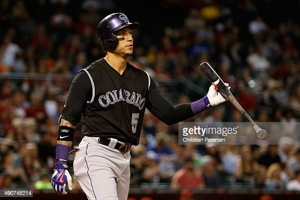 Carlos Gonzalez of the Colorado Rockies reacts after striking out against the Arizona Diamondbacks during the fifth inning of the MLB game at Chase...
