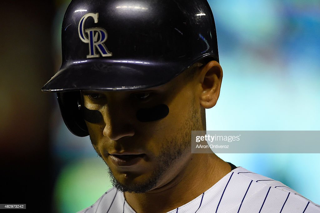 Carlos Gonzalez (5) of the Colorado Rockies reacts to grounding out for the second out of the bottom of the seventh inning against the Seattle Mariners during an inter league game at Coors Field. The Colorado Rockies hosted the Seattle Mariners on Tuesday, August 4, 2015.