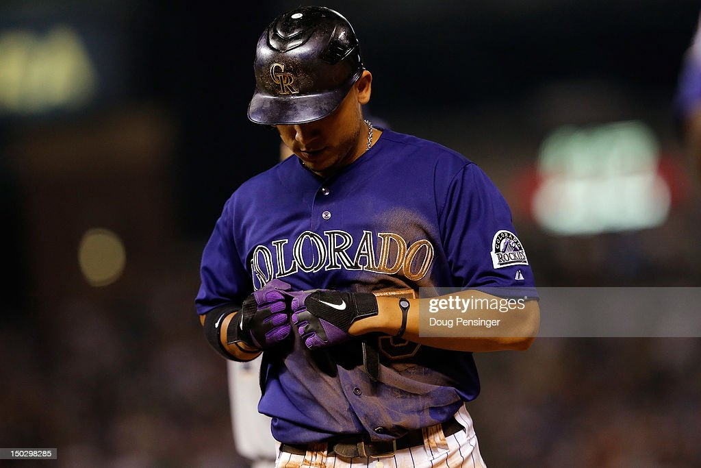 Carlos Gonzalez #5 of the Colorado Rockies returns to the dugout after being caught stealing against the Milwaukee Brewers at Coors Field on August 14, 2012 in Denver, Colorado. The Rockies defeated the Brewers 8-6.