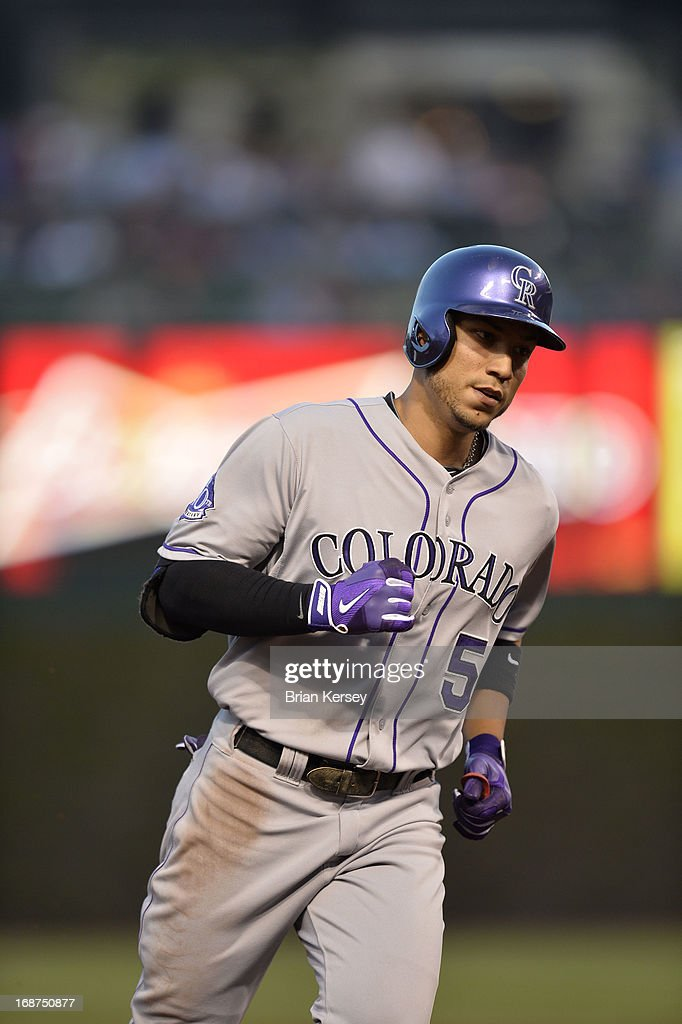 Carlos Gonzalez #5 of the Colorado Rockies rounds the bases after hitting a solo home run during the third inning against the Chicago Cubs on May 14, 2013 at Wrigley Field in Chicago, Illinois.