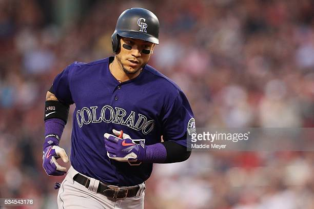Carlos Gonzalez of the Colorado Rockies rounds the bases after hitting a two run homer during the fourth inning against the Boston Red Sox at Fenway...