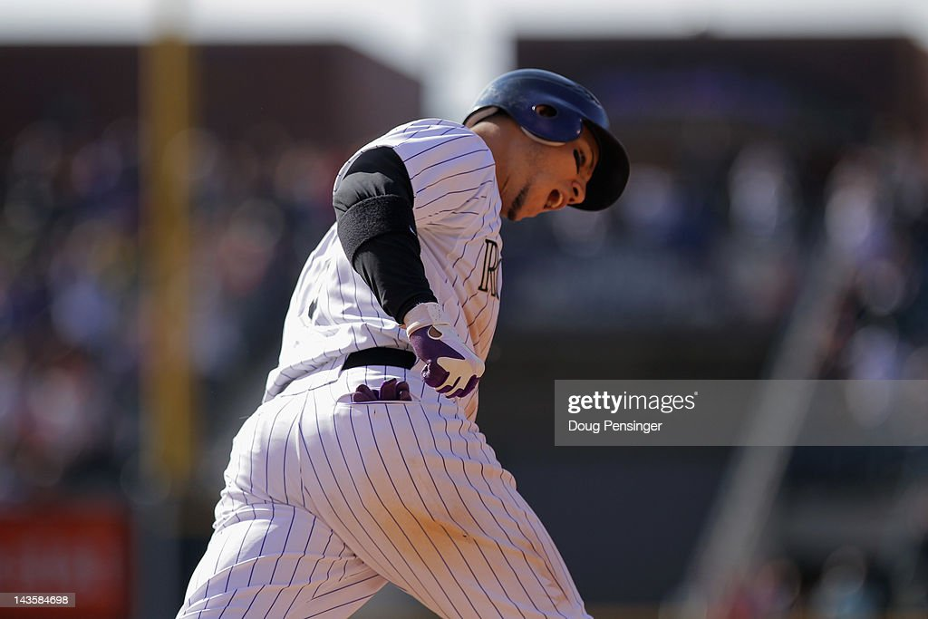Carlos Gonzalez #5 of the Colorado Rockies rounds the bases on his solo home run against the New York Mets to tie the score in the 10th inning at Coors Field on April 29, 2012 in Denver, Colorado. The Mets defeated the Rockies 6-5 in 11 innings.