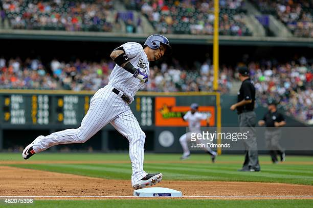 Carlos Gonzalez of the Colorado Rockies rounds third base on his way to scoring off of a two run RBI triple by Ben Paulsen during the first inning...