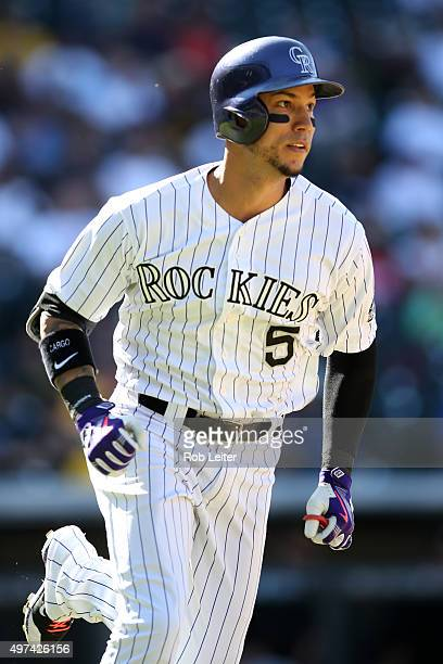 Carlos Gonzalez of the Colorado Rockies runs during the game against the Pittsburgh Pirates at Coors Field on September 24 2015 in Denver Colorado...