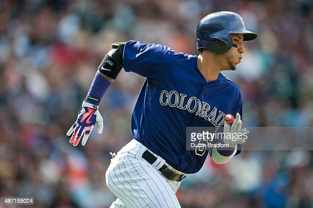 Carlos Gonzalez of the Colorado Rockies runs out a fourth inning double against the San Francisco Giants during a game at Coors Field on September 6...