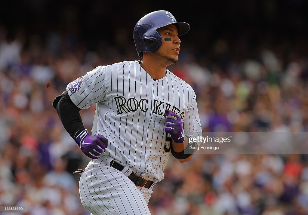 Carlos Gonzalez #5 of the Colorado Rockies runs the bases against the San Diego Padres during Opening Day at Coors Field on April 5, 2013 in Denver, Colorado. The Rockies defeated the Padres 5-2.