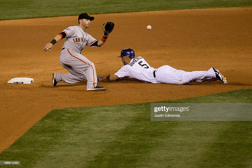 Carlos Gonzalez #5 of the Colorado Rockies slides in safely for a stolen base before second baseman <a gi-track='captionPersonalityLinkClicked' href=/galleries/search?phrase=Marco+Scutaro&family=editorial&specificpeople=239523 ng-click='$event.stopPropagation()'>Marco Scutaro</a> #19 of the San Francisco Giants can make the catch and tag during the fifth inning at Coors Field on May 16, 2013 in Denver, Colorado. The Giants defeated the Rockies 8-6.