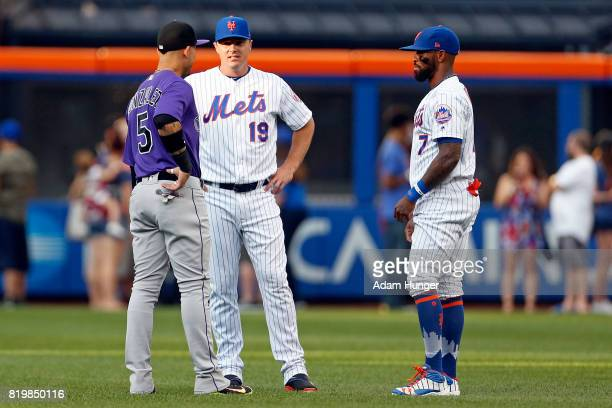 Carlos Gonzalez of the Colorado Rockies speaks with Jay Bruce of the New York Mets and Jose Reyes of the New York Mets prior to their game at Citi...