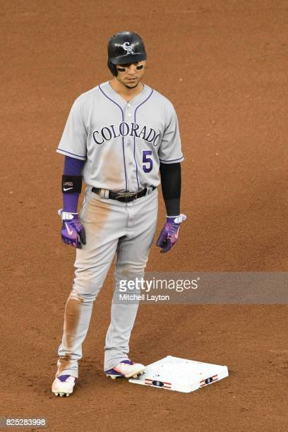 Carlos Gonzalez of the Colorado Rockies stands on second base during a baseball game against the Washington Nationals at Nationals Park on July 29...