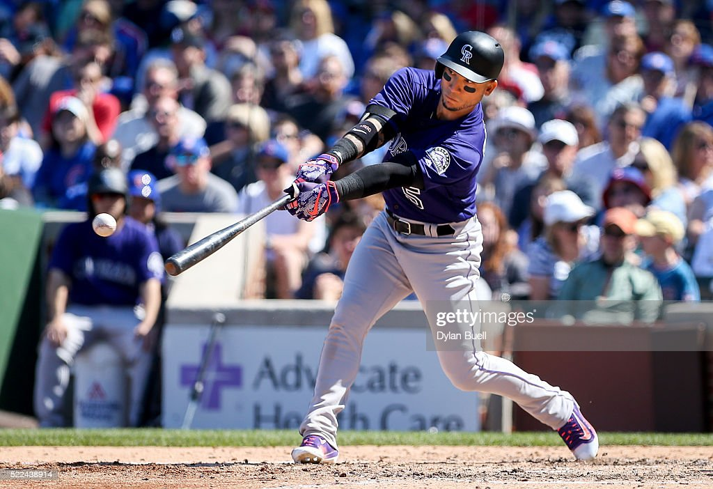 Carlos Gonzalez #5 of the Colorado Rockies swings at a pitch in the sixth inning against the Chicago Cubs at Wrigley Field on April 17, 2016 in Chicago, Illinois.