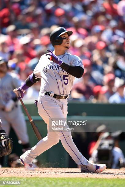 Carlos Gonzalez of the Colorado Rockies takes a swing during game one of a doubleheader baseball game against the Washington Nationals at Nationals...