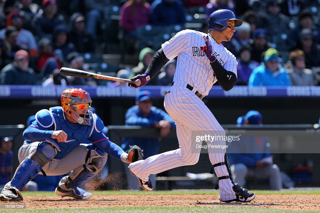 Carlos Gonzalez #5 of the Colorado Rockies takes an at bat as catcher <a gi-track='captionPersonalityLinkClicked' href=/galleries/search?phrase=John+Buck&family=editorial&specificpeople=213730 ng-click='$event.stopPropagation()'>John Buck</a> #44 of the New York Mets backs up the plate at Coors Field on April 18, 2013 in Denver, Colorado. The Rockies defeated the Mets 11-3.