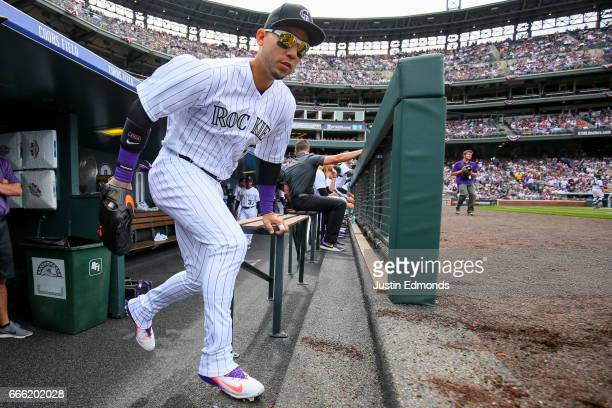 Carlos Gonzalez of the Colorado Rockies takes the field against the Los Angeles Dodgers on Opening Day at Coors Field on April 7 2017 in Denver...