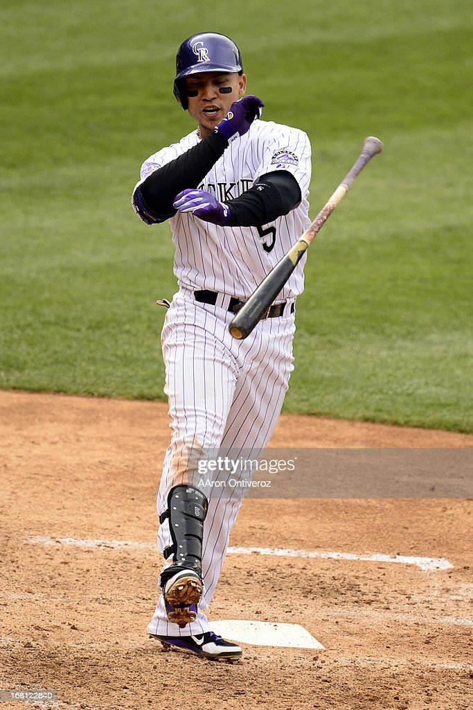 Carlos Gonzalez (5) of the Colorado Rockies throws his bat after striking out against the Tampa Bay Rays during the Rockies' 8-3 loss. The Tampa Bay Rays took two of three games from the Rockies in the series.