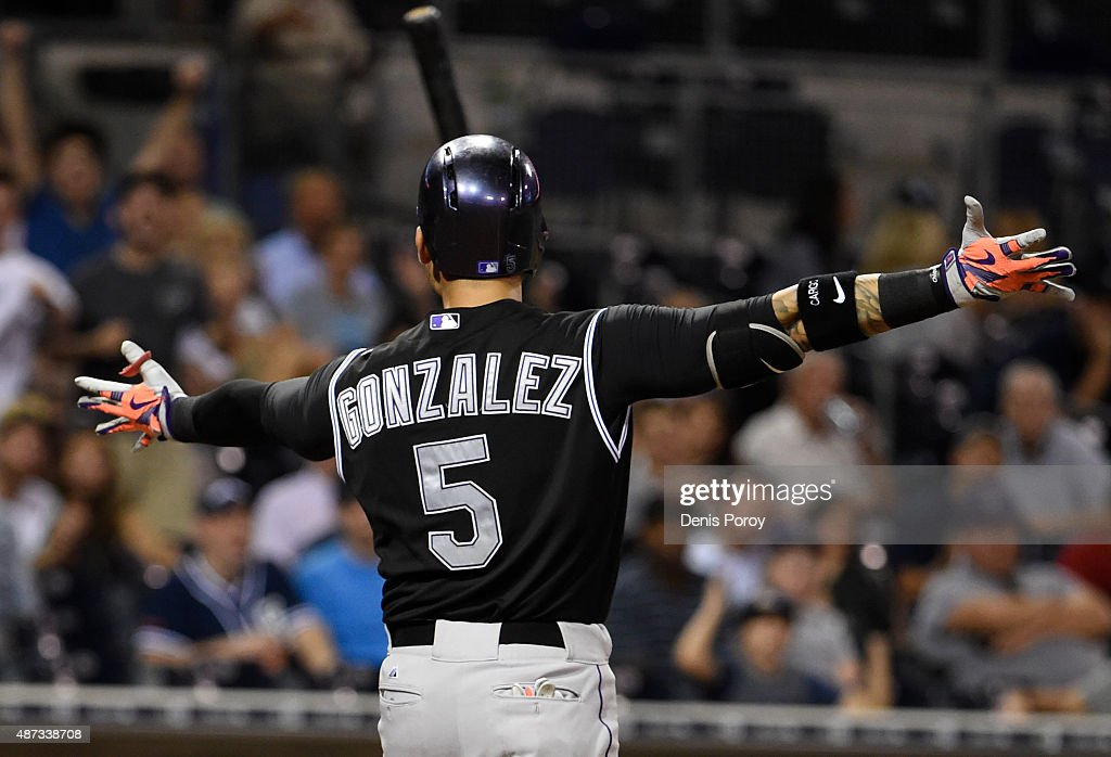 Carlos Gonzalez #5 of the Colorado Rockies throws his bat as he reacts to a called strike three during the ninth inning of a baseball game against the San Diego Padres at Petco Park September 8, 2015 in San Diego, California.