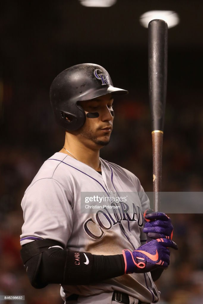Carlos Gonzalez #5 of the Colorado Rockies warms up on deck during the seventh inning of the MLB game against the Arizona Diamondbacks at Chase Field on September 12, 2017 in Phoenix, Arizona.
