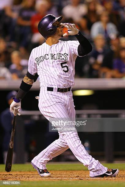 Carlos Gonzalez of the Colorado Rockies watches his sacfly RBI during the fourth inning against the San Diego Padres at Coors Field on September 19...