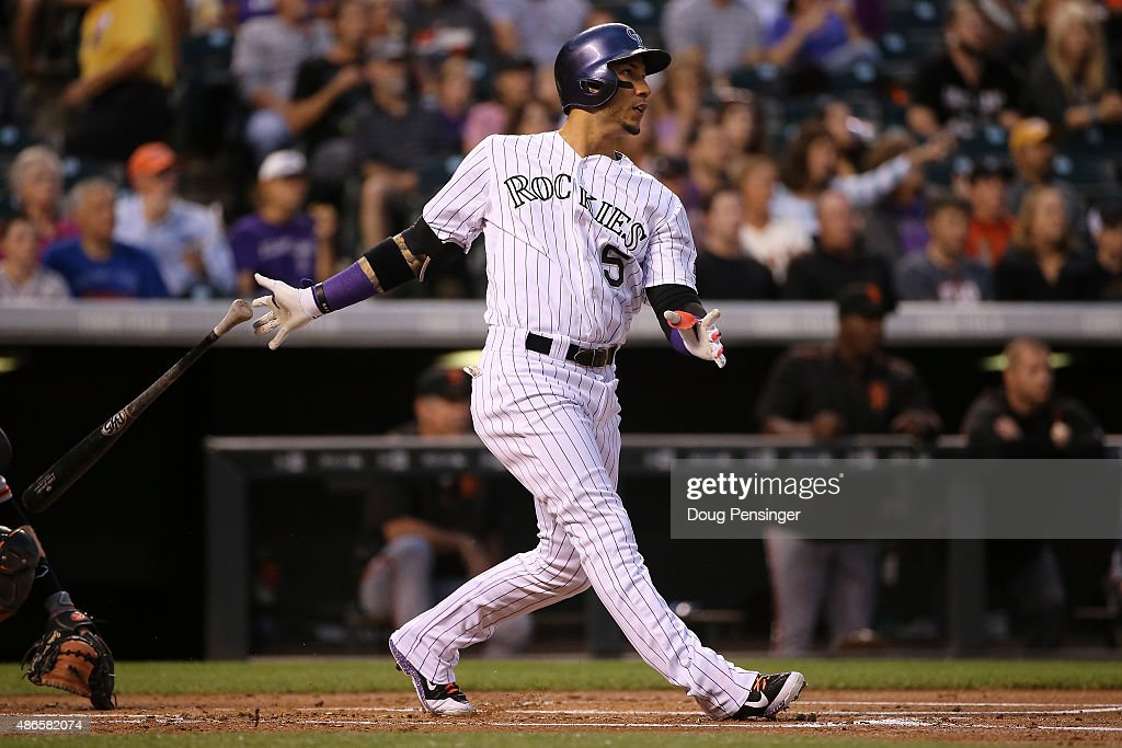 <a gi-track='captionPersonalityLinkClicked' href=/galleries/search?phrase=Carlos+Gonzalez+-+Amerikansk+basebollspelare&family=editorial&specificpeople=7204259 ng-click='$event.stopPropagation()'>Carlos Gonzalez</a> #5 of the Colorado Rockies watches his solo home run off of starting pitcher Chris Heston #53 of the San Francisco Giants to take a 1-0 lead in the first inning at Coors Field on September 4, 2015 in Denver, Colorado.