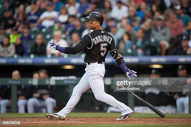 Carlos Gonzalez of the Colorado Rockies watches the flight of a second inning home run against the Cincinnati Reds at Coors Field on May 31 2016 in...
