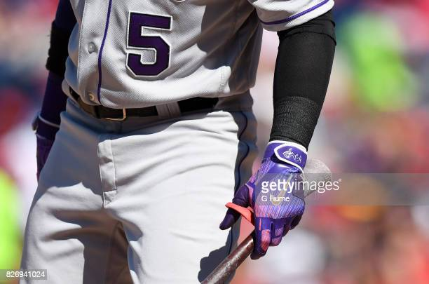 Carlos Gonzalez of the Colorado Rockies wears Nike batting gloves during the game against the Washington Nationals at Nationals Park on July 30 2017...