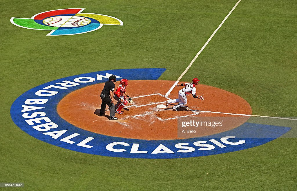 Carlos Gonzalez #5 of Venezuela gets a hit against Spain during the first round of the World Baseball Classic at Hiram Bithorn Stadium on March 10, 2013 in San Juan, Puerto Rico.