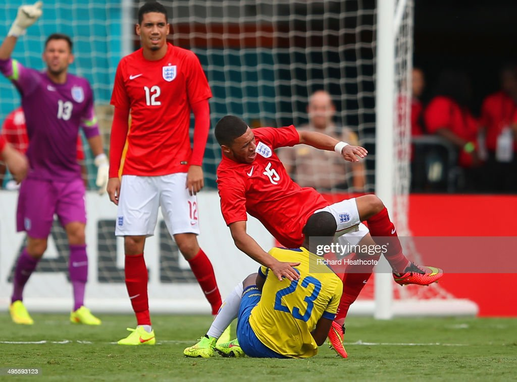 Carlos Gruezo of Ecuador brings down <a gi-track='captionPersonalityLinkClicked' href=/galleries/search?phrase=Alex+Oxlade-Chamberlain&family=editorial&specificpeople=7191518 ng-click='$event.stopPropagation()'>Alex Oxlade-Chamberlain</a> of England during the International friendly match between England and Ecuador at Sun Life Stadium on June 4, 2014 in Miami Gardens, Florida.