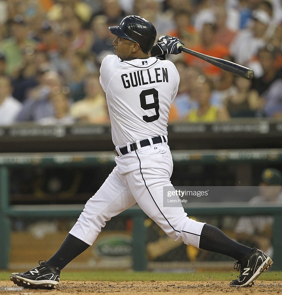Carlos Guillen #9 of the Detroit Tigers hits a two run home run in the fifth inning scoring Jhonny Peralta #27 during the game against the Oakland Athletics at Comerica Park on July 19, 2011 in Detroit, Michigan.