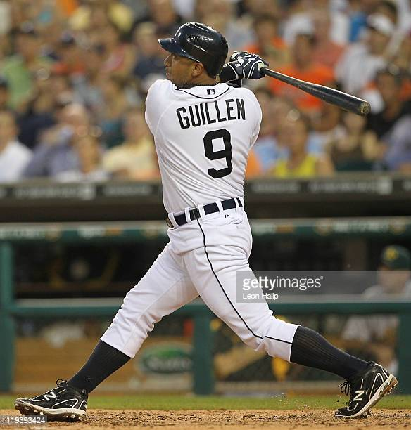 Carlos Guillen of the Detroit Tigers hits a two run home run in the fifth inning scoring Jhonny Peralta during the game against the Oakland Athletics...