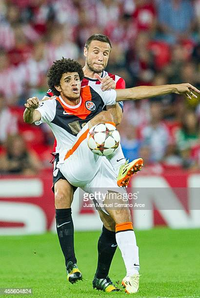 Carlos GurpegiÊ of Athletic Club Bilbao duels for the ball with Taison of Shakhtar Donetsk during the UEFA Champions League Group H match between...