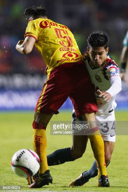 Carlos Guzman of Morelia and Diego Lainez of America fight for the ball during the seventh round match between Morelia and America as part of the...