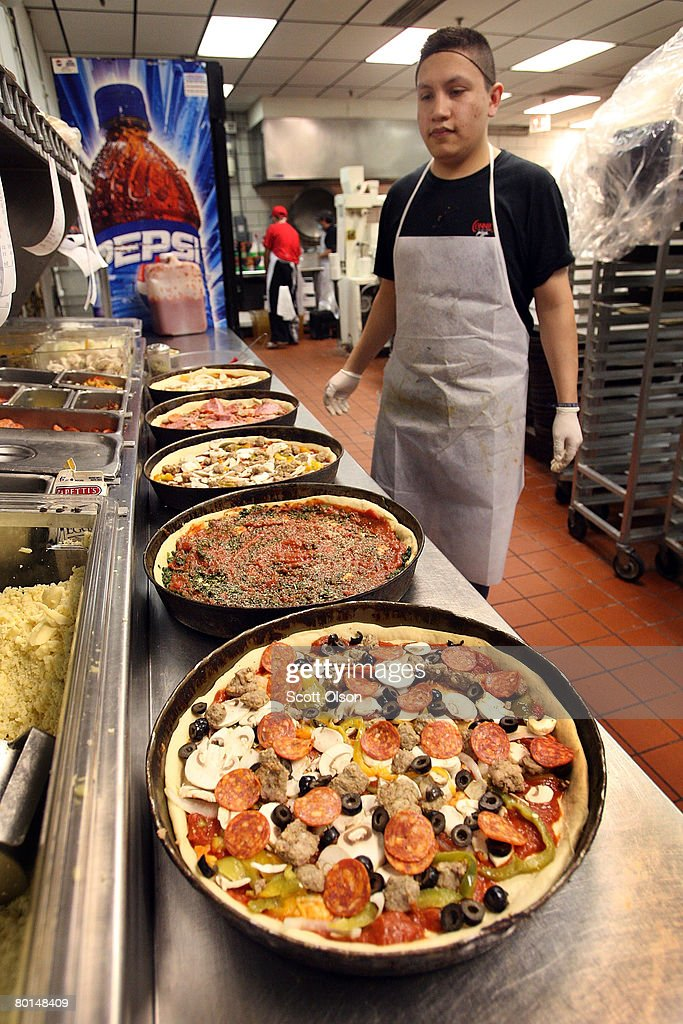 Carlos Guzman prepares a deep dish pizza at Connie's Pizza on March 6, 2008 in Chicago, Illinois. The cost of flour, a key ingredient in making pizza dough, has more than doubled in the past year because of high wheat prices caused by strong worldwide demand and increased price speculation. Connie's Pizza makes between 10 to 20 thousand pizzas each week.