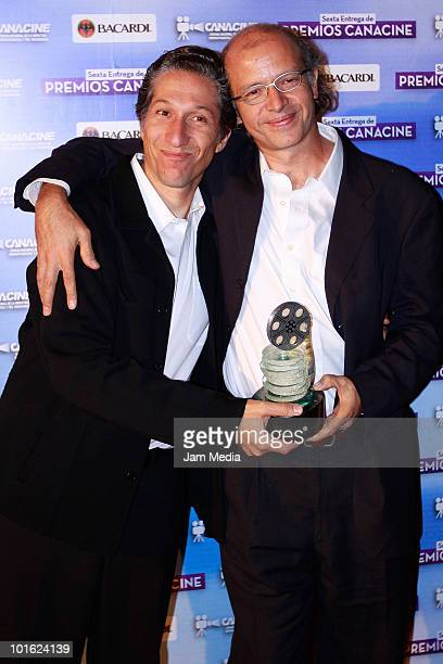 Carlos Hagerman and Juan Carlos Rulfo pose for a photo during the CANACINE awards at Economist Musuem on June 3 2010 in Mexico City Mexico