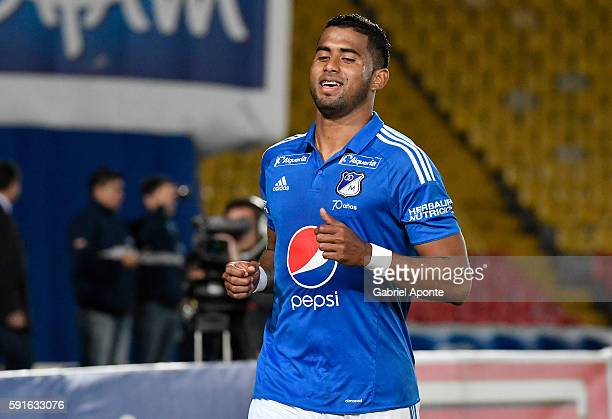 Carlos Henao of Millonarios celebrates after scoring the opening goal during a match between Millonarios and Deportivo Cali as part of round 14 of...
