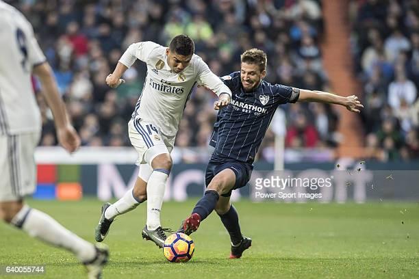 Carlos Henrique Casemiro of Real Madrid competes for the ball with Ignacio Camacho Barnola of Malaga CF during their La Liga 201617 match between...