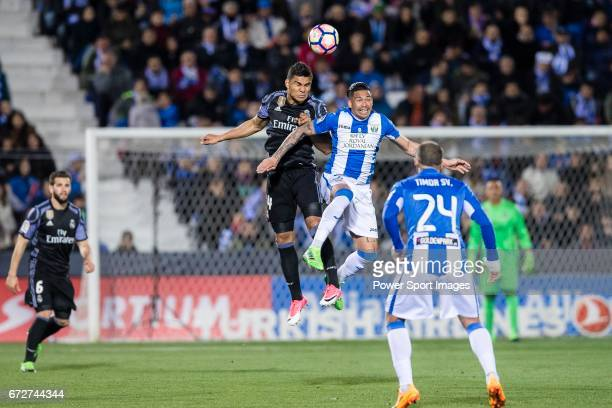 Carlos Henrique Casemiro of Real Madrid competes for the ball with Luciano Neves of Deportivo Leganes during their La Liga match between Deportivo...